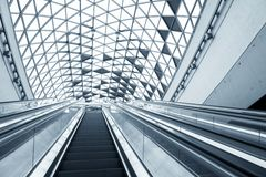 Moving escalator in the business center Royalty Free Stock Photography