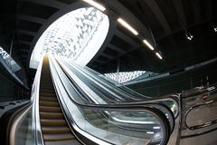 Moving escalator in the business center Stock Photo
