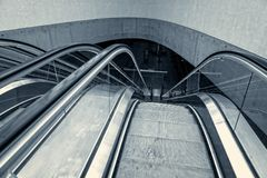 Moving escalator in the business center Stock Image