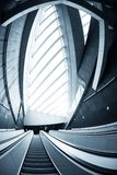 Moving escalator in the business center Royalty Free Stock Images