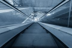 Moving escalator in the business center Royalty Free Stock Image