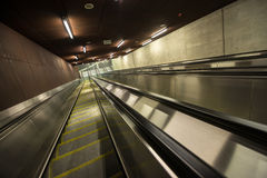 Moving escalator in the business center Royalty Free Stock Photos