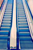 Moving escalator, cross process Royalty Free Stock Images