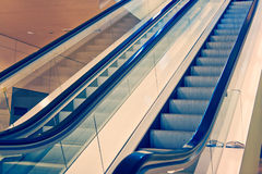 Moving escalator, cross process Stock Photography