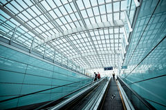 Moving escalator in modern airport hall Stock Images