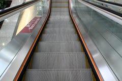 Moving escalator in office center. A moving escalator in a office Stock Photos