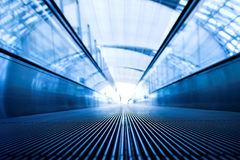 Moving escalator in office hall Royalty Free Stock Images