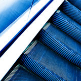 Moving escalator in the office hall. Perspective view of moving escalator in the office hall Royalty Free Stock Image