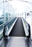 Moving  escalator in the office hall Stock Images