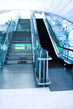 Moving escalator in the office hall. Perspective view Stock Photo