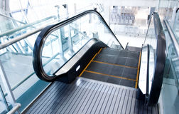 Moving  escalator in the office hall Stock Image