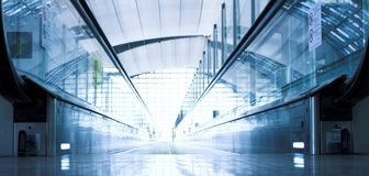 Moving escalator in the office hall. Perspective view Royalty Free Stock Photography
