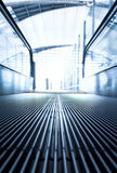 Moving  escalator in the office hall Stock Photography