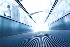Moving  escalator in the office hall Stock Photos