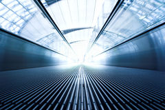 Moving  escalator in the office hall Royalty Free Stock Photography