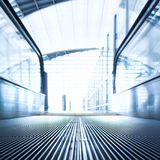 Moving  escalator in the office hall Royalty Free Stock Image