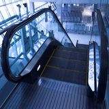 Moving  escalator in the office hall Stock Photo