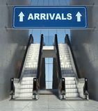 Moving escalator stairs in airport, arrivals sign. Moving escalator stairs in modern airport, arrivals sign Royalty Free Stock Photos