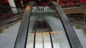 Moving escalator up, mecanic, electic, Stair and escalators in a public area. hd footage 1080. Close-up shot of empty moving staircase running up and down stock video