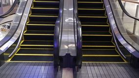 Moving escalator up in a public area. hd footage. 1080 stock footage