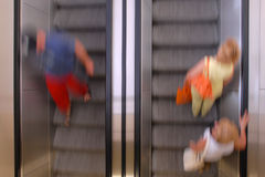 Moving on escalators Stock Photography
