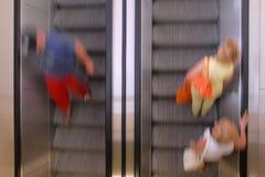 Moving on escalators Stock Photography