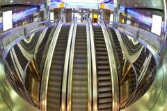 Moving escalators Stock Images