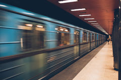 Moving fast metro train in the underground, high speed motion sh Royalty Free Stock Photography