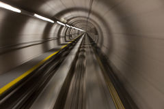 Moving fast through a modern, conrete tunnel stock images