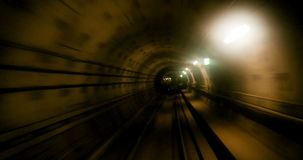 Moving fast in subway tunnel. Getting out from subway tunnel in yellow color - concept of finish, dedication and hard work