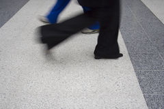 Moving Feet. Legs moving across floors quickly royalty free stock images