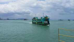 Moving ferry in Penang, Malaysia. Green Ferry moving at Selat Melaka Royalty Free Stock Photography