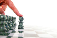 Moving forward. Chess piece moving forward on the board Stock Photography