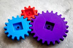Moving forward concept with gears. Right decision and correct solution. stone desk background Stock Photo