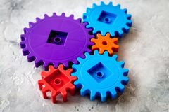 Moving forward concept with gears. Right decision and correct solution. stone desk background Royalty Free Stock Images