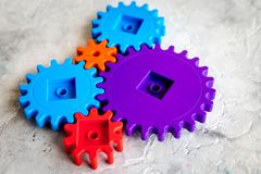 Moving forward concept with gears. Right decision and correct solution. stone desk background Royalty Free Stock Photo