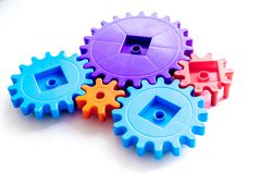 Moving forward concept with gears. Right decision and correct solution. on white desk background Royalty Free Stock Image