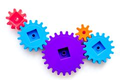 Moving forward concept with gears. Right decision and correct solution. white desk background top view mockup. Moving forward concept with gears. Right decision Royalty Free Stock Image