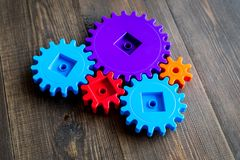 Moving forward concept with gears. Right decision and correct solution. wooden desk background Stock Image