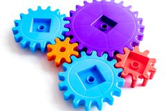 Moving forward concept, ideal operating principle with gears and wheels on white background. Moving forward concept, ideal operating principle with gears and royalty free stock image