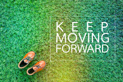 MOVING FORWARD concept with show on grass field.jpg. MOVING FORWARD concept with show on grass field texture.jpg Stock Photo
