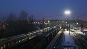 Moving freight train on railway at winter night. Moving long freight train on railway at winter night stock video