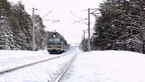 Moving freight train in winter Russian forest stock video