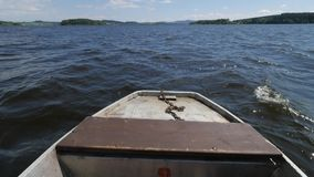 Moving front part of fishing vessel boat on lake in wind. Moving front part of fishing vessel boat on big lake in windy weather stock video footage