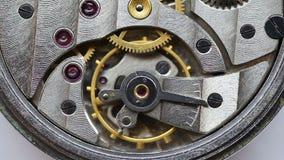 Moving gears inside old mechanic pocket watch stock footage
