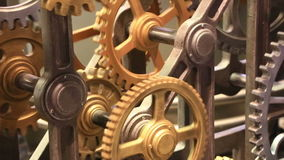 Moving gears of old mechanism close up stock video footage