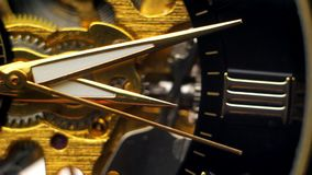 The moving hands of the clock against the background of the naked clock mechanism. Full HD stock footage