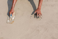 Moving hands and shadow of mason worker using steel trowel plast Stock Images