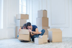 Moving home and repair of a new life. Couple in love pulls thing Stock Images