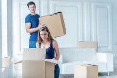 Moving home and repair of a new life. Couple in love pulls thing Stock Image